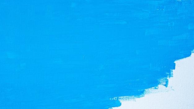 Pintura abstracta de color azul con un pincel y texturas de líneas de dibujo de color de aceite de color de agua sobre fondo de lienzo blanco