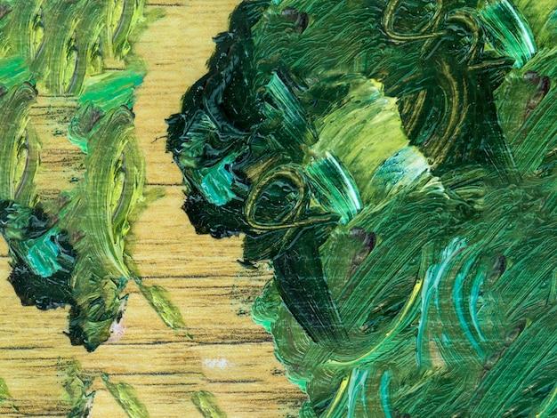 Pintura abstracta verde sobre madera