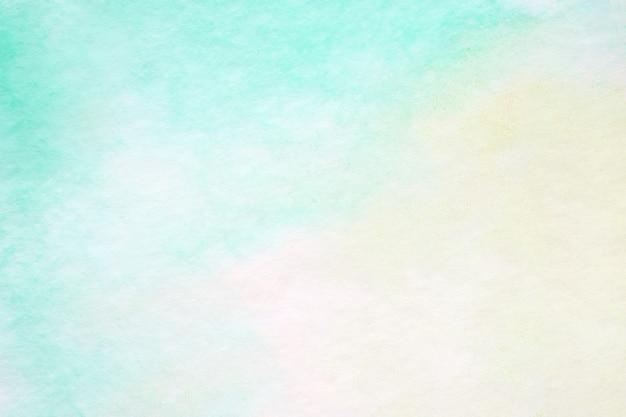La pintura de acuarela abstracta verde texturizada en el fondo del papel blanco, el arte y el arte diseñan el fondo