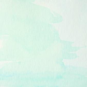 Pintura acuarela azul y verde con textura sobre papel blanco