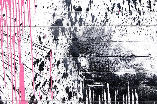 Pintura en aerosol de color negro y rosa o fondo de graffiti