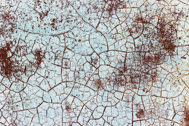 Pintura agrietada en textura de fondo de hierro oxidado