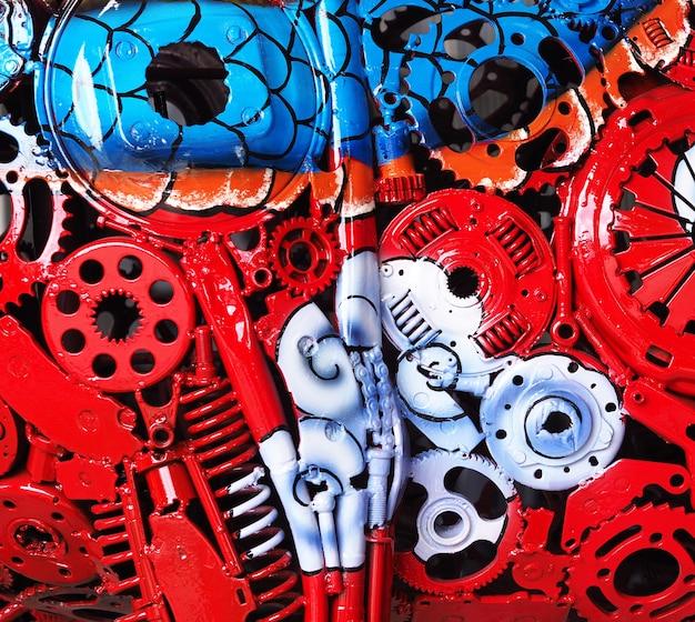 Pintura al óleo colorida en un primer de la máquina de la parte.