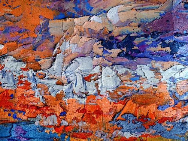 Pintura al óleo colorida sobre fondo abstracto de lona con textura.