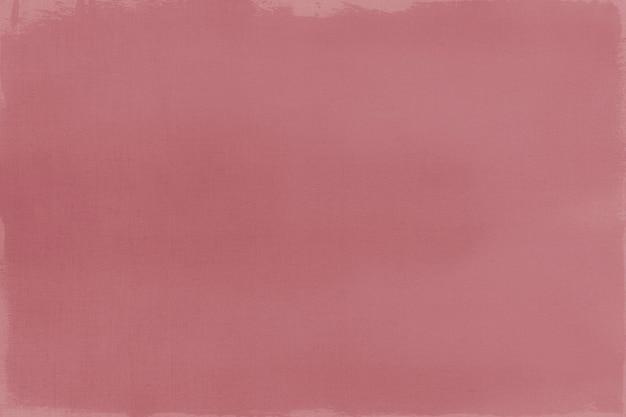 Pintura de color rojo oscuro sobre un lienzo con textura