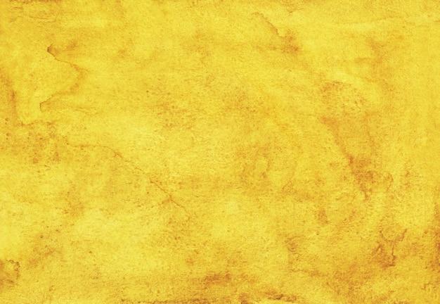 Pintura de fondo amarillo dorado de acuarela. fondo arenoso acuarela. textura pintada a mano.