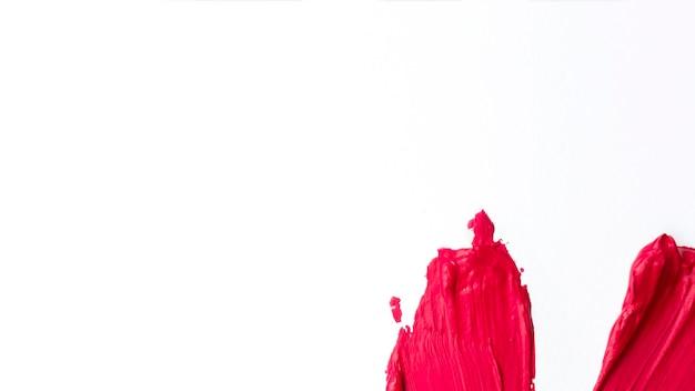 Pintura minimalista con trazos rojos.