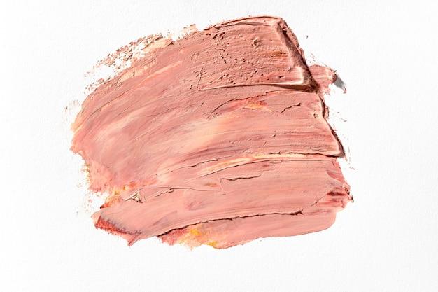 Pintura rosa sobre fondo blanco.