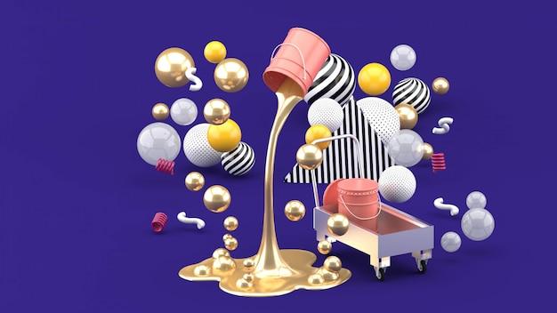 Pinturas líquidas doradas que brotan de la lata rosada entre las bolas de colores en la púrpura. render 3d