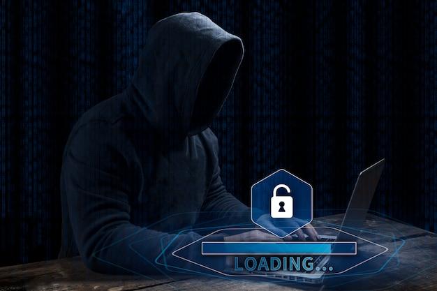 Pirata informático de ordenador anónimo sobre fondo digital abstracto. rostro oscuro obscurecido en máscara y capucha.