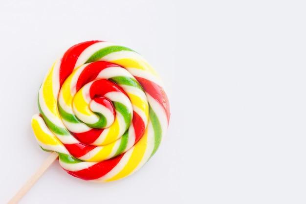 Piruleta redonda multicolor con rayas.