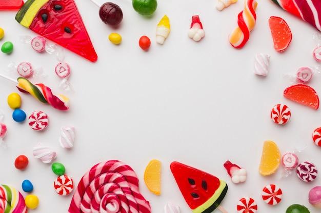 Piruletas y dulces con espacio de copia