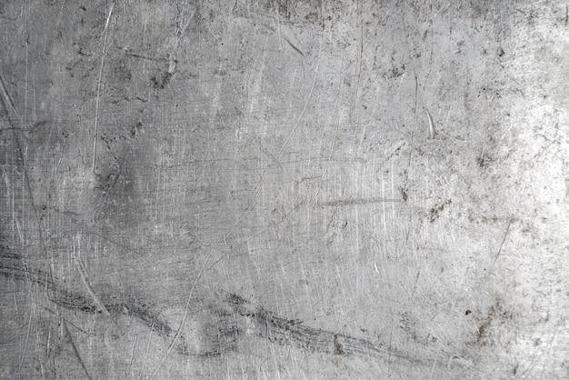 Piso apenado de patrones sin fisuras, fondo blanco y gris, estuco grunge. cemento o muro de hormigón texturizado
