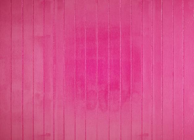 Piso o pared de tablas de madera pintadas de rosa