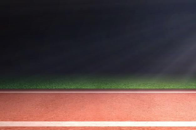 Pista de atletismo con hierba verde y luz