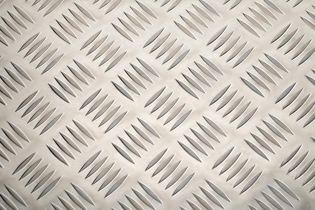 Placa de metal de aluminio antideslizante con textura o fondo de patrón de diamante