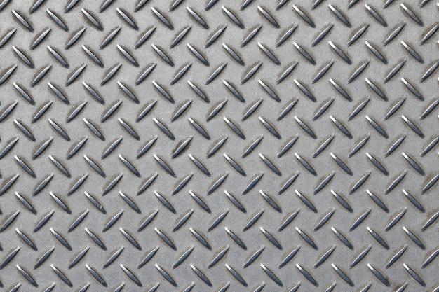 Placa de metal gris antideslizante con patrón de rombos