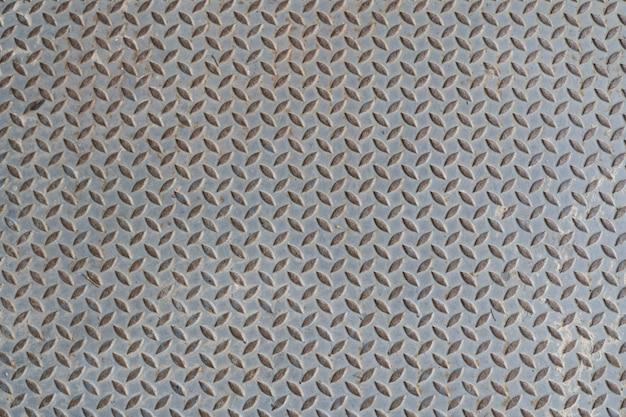 Placa de piso de metal de acero viejo con fondo de textura de patrón de diamante