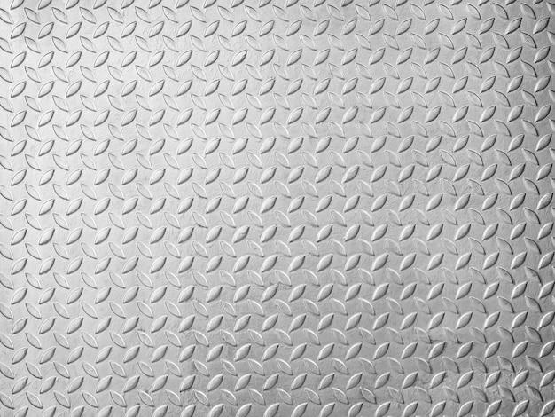 Placa de piso de metal con textura de patrón de diamante. panel de acero plateado con patrón diagonal, sin costuras de fondo metálico de chapa de acero.