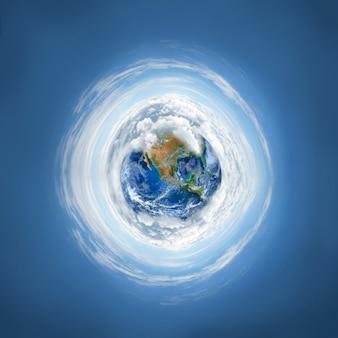 El planeta tierra con nube.
