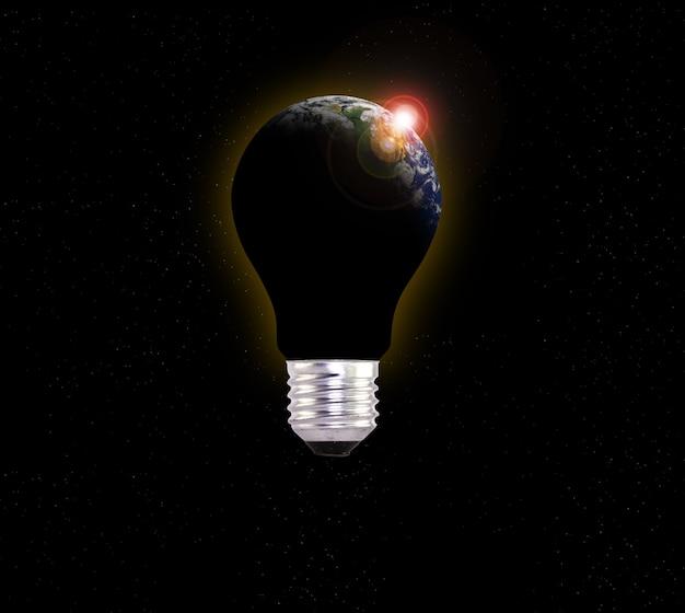 Planeta tierra oscuro en una bombilla