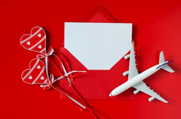 Planificación de viajes en el día de san valentín. concepto de viaje, maqueta.