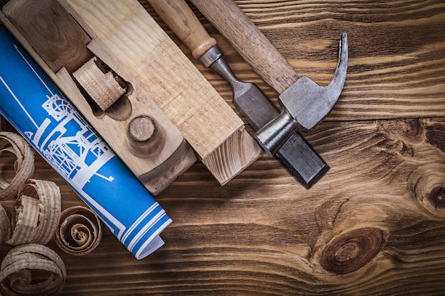 Plano de construcción azul afeitado plano garra martillo cincel de madera s
