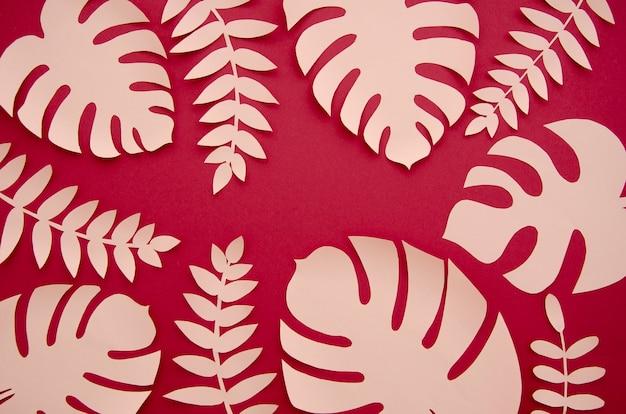 Plantas monstera rosadas tropicales en el estilo de papel cortado