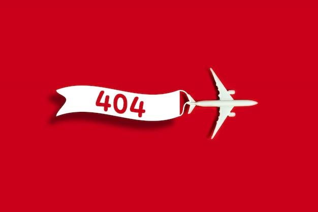 La plantilla informa que la página no se encuentra con un modelo de avión de juguete y una cinta