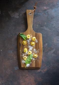 Plato de tortellinis con ricotta y espinacas.