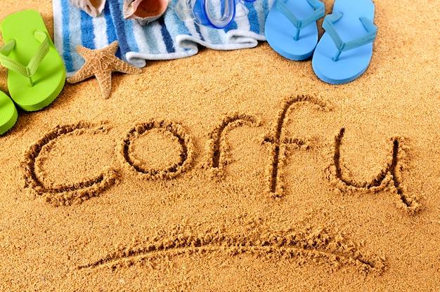 Playa de corfu escribiendo