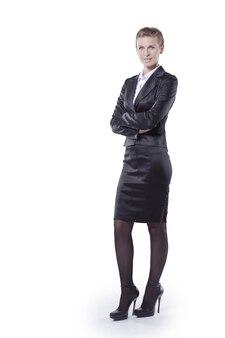 En pleno crecimiento.mujer de negocios joven ejecutiva en traje negro.en aislamiento