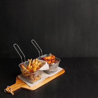 Pollo frito y patatas fritas