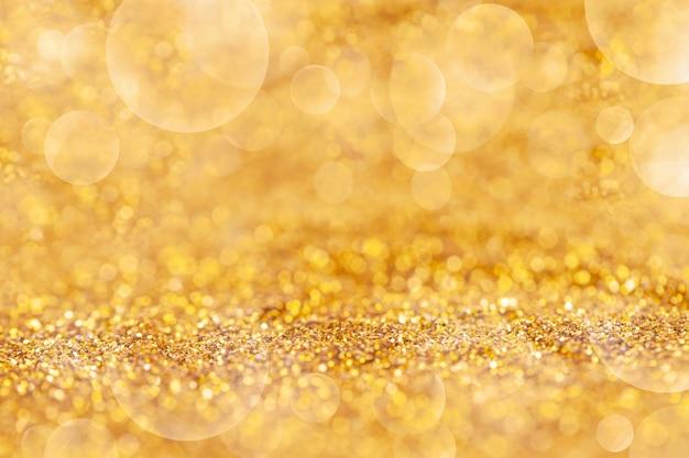 Polvo de oro elegante con bokeh resumen o textura de fondo