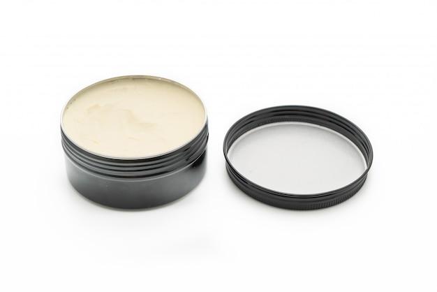 Pomada para peinar el cabello en aceite a base de pared blanca