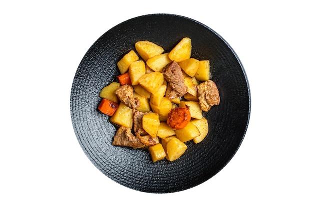 Porción de gulash de verduras asadas con patatas y carne