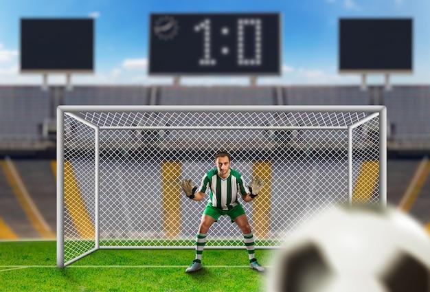 Portero atrapando el balón en el campo de fútbol
