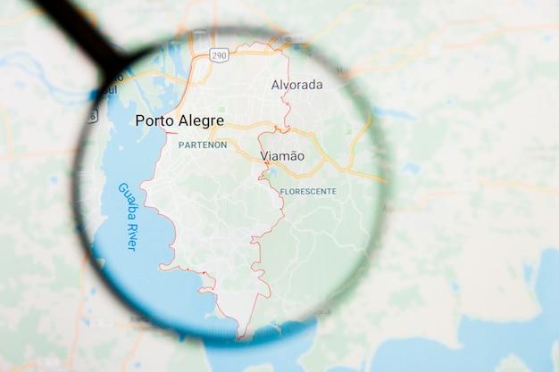 Porto alegre, brasil, visualización de la ciudad, concepto ilustrativo en la pantalla a través de una lupa