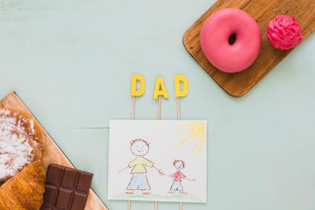 Postres cerca del dibujo para papá