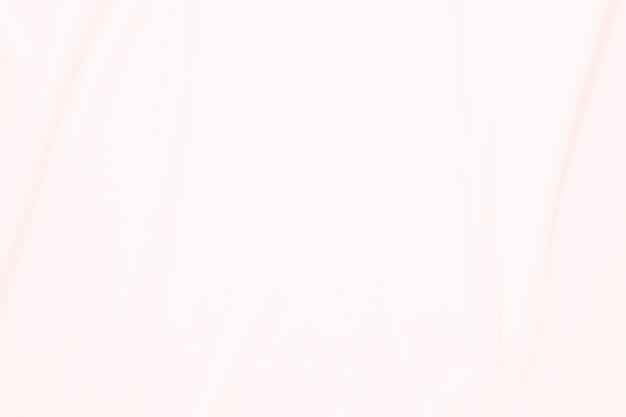 Primer elegante arrugado del fondo y de la textura rosados del paño de la tela de seda.