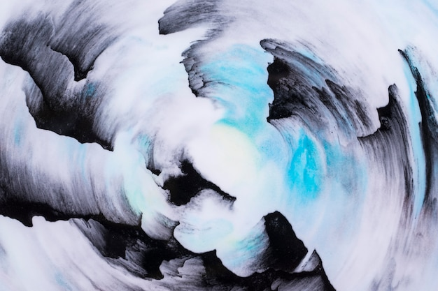 Primer del fondo azul y negro abstracto del movimiento del cepillo de pintura de aceite