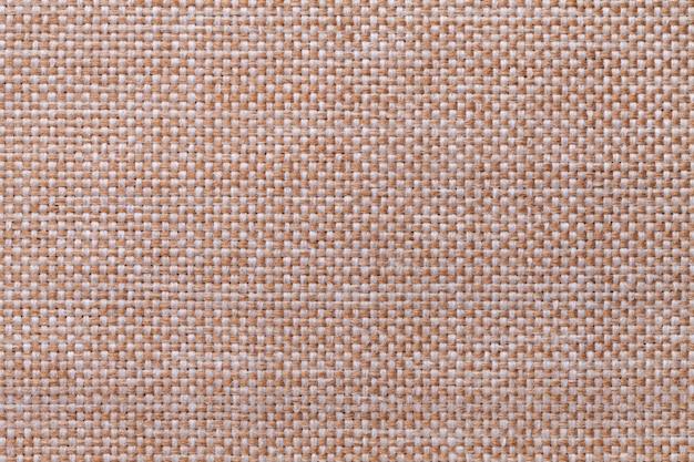 Primer marrón claro del fondo de la materia textil. estructura de la macro de la tela.