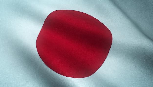 Primer plano de la bandera ondeante de japón con texturas interesantes