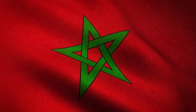 Primer plano de la bandera ondeante de marruecos con texturas interesantes