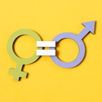 Primer plano de concepto de calidad de símbolos de género masculino verde azul y femenino