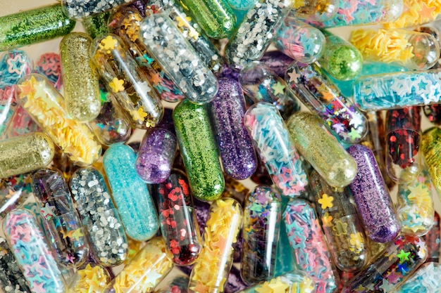Primer plano de fondo de cápsulas de píldoras brillantes shimmery brillante