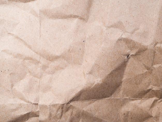 Primer plano de fondo de papel arrugado de color beige
