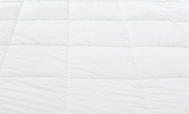 Primer plano de fondo de patrón de hoja de ropa de cama blanca