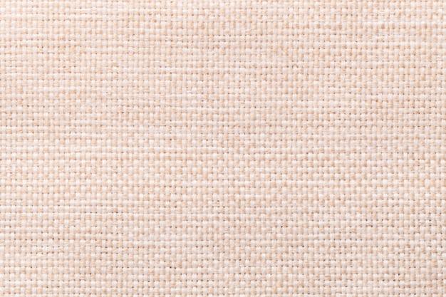 Primer plano de fondo textil beige claro, estructura de la macro de tela