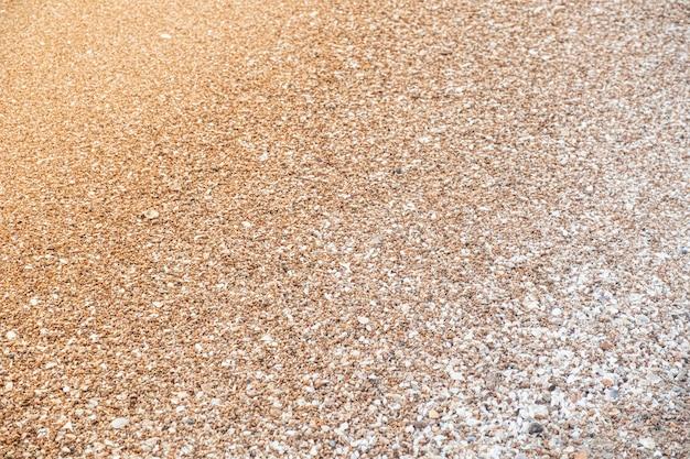 Primer plano del patrón de arena de textura de un fondo de playa